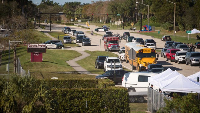 The view from the Sawgrass Expressway towards the entrance to Marjory Stoneman Douglas High School in Parkland on Thursday, Feb. 15, 2018, following Wednesday's mass casualty school shooting.