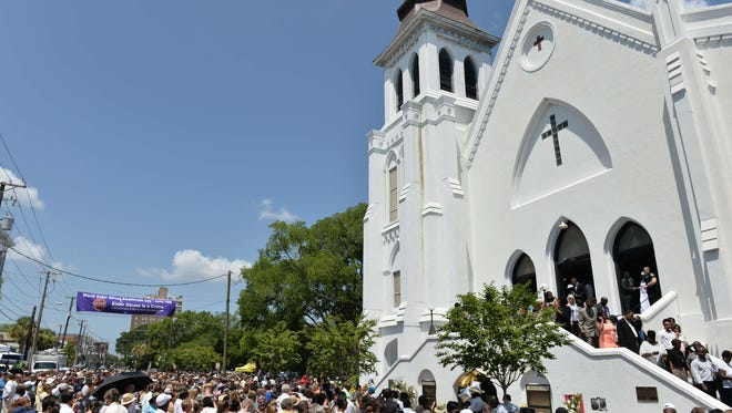 This file photo shows the congregation departing following Sunday services at the Emanuel AME Church in Charleston, South Carolina on June 21, 2015.