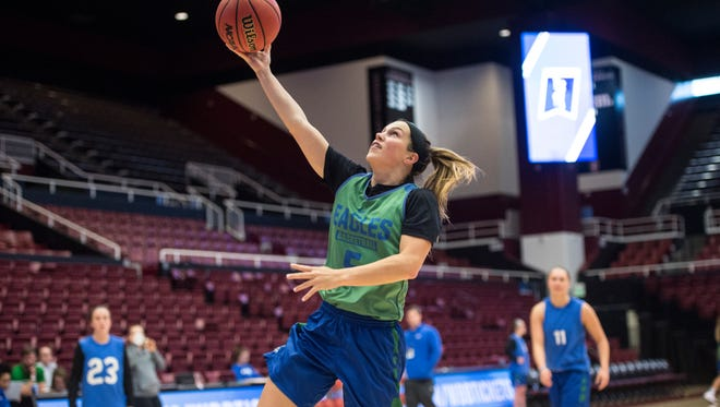 FGCU junior guard Lisa Zderadicka goes in for a layup in Stanford's Maples Pavilion during Sunday's practice. The 12th-seeded Eagles take on fourth-seeded Stanford in an NCAA tournament second-rounder at 9 p.m. Monday.