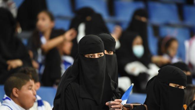 Saudi female fans watch the AFC Champions League football match between Saudi al-Hilal and Qatari al-Rayyan at the King Saudi University stadium in Riyadh on March 6, 2018.