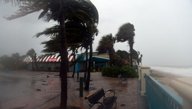 The wind rips through Sexton Plaza on Sunday, Sept. 10, 2017, as Hurricane Irma approaches the Treasure Coast.