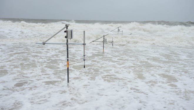 Sensors measure water speed and beach erosion during a nor'easter in Bethany Beach on Tuesday, March 20, 2018.