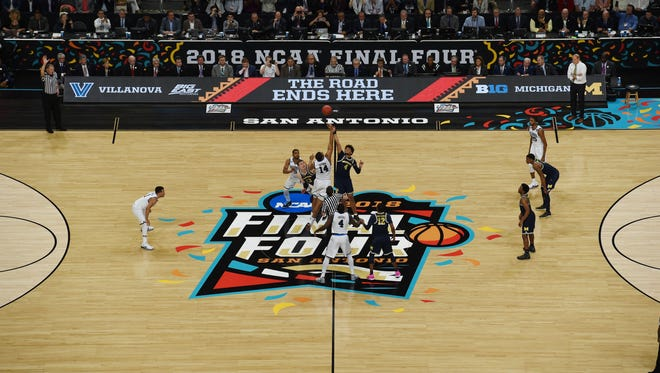 Villanova Wildcats forward Omari Spellman (14) and Michigan Wolverines forward Isaiah Livers (4) jump for the tip-off in the championship game of the 2018 men's Final Four at Alamodome.