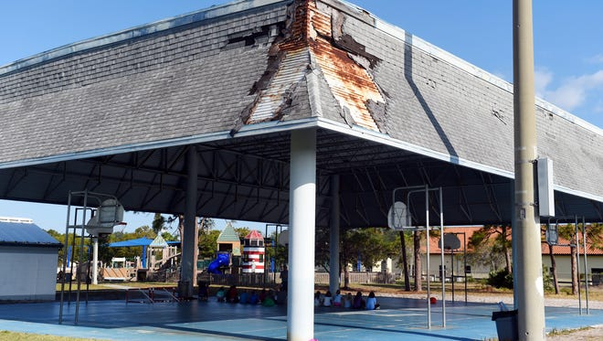 Damage to the covering of the outdoor basketball courts at Jensen Beach Elementary School is just one of the many structural blemishes of the school, built in 1970. Narrow hallways, siding missing from the exterior walls of classrooms, flooding in classrooms when it rains and permanently fogged over windows are among some of the problems for the school.
