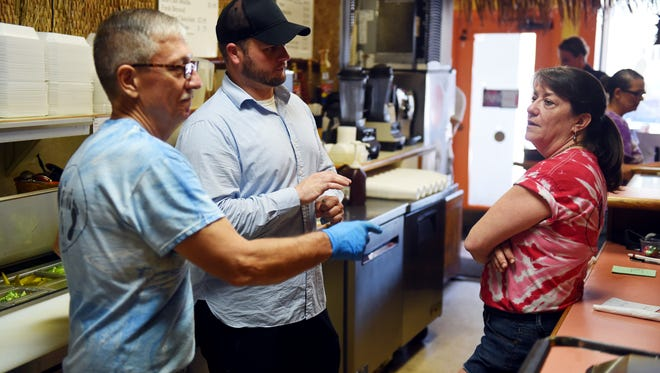 Will Watkins (center), 31, recently bought The Barefoot Cafe from Steve and Lisa Horn who opened their doors in 2007 in downtown Vero Beach. The Horns have decided that it's time to focus more on their other passion - traveling the country visiting national parks.