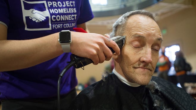 """Stephen Wildgen, known as """"The Colonel,"""" gets a free haircut as he attends a Project Homeless Connect event at the Northside Aztlan Center on Friday, April 13, 2018. Services like health screenings, clothing distribution and bike repair were utilized by hundreds of homeless or at-risk people."""