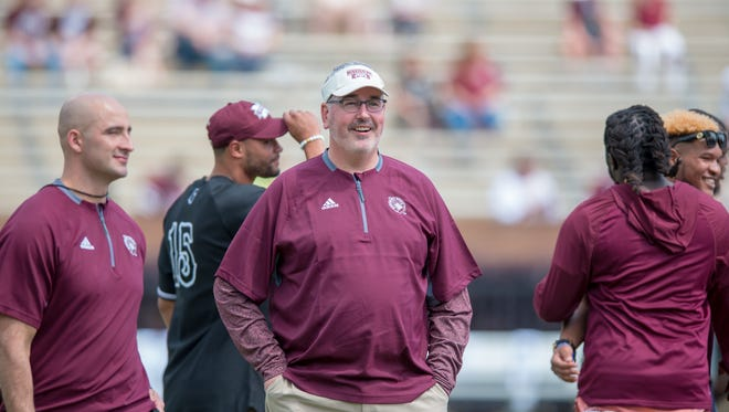 Joe Moorhead laughs before the annual Maroon and White game at Davis Wade Stadium on the Campus of Mississippi State University on April 21, 2018.