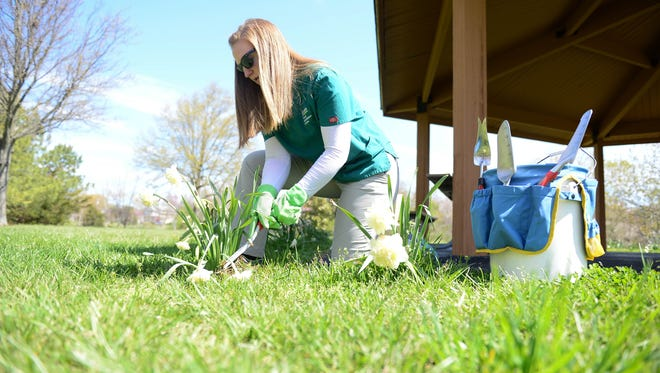Katie Merk, Occupational Therapist with Beebe Hospital, shows the proper posture and technique to help prevent any injuries while gardening on Thursday, April 26, 2018.