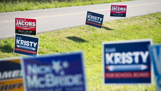 Signs stand on the front lawn at Gap Creek Elementary School Tuesday, May 1, 2018.
