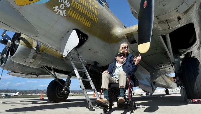"World War II veteran John Mihalsky, of Thousand Oaks, and daughter Donna Mihalsky, of Thousand Oaks, visit a B-17 bomber ""Fighting Fortress"" as several vintage planes arrived at the Camarillo Airport on Thursday for the Collings Foundation's Wings of Freedom Tour."