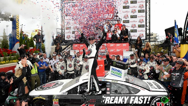 Kevin Harvick celebrates in Victory Lane after he won the NASCAR Cup Series auto race, Sunday, May 6, 2018, at Dover International Speedway.