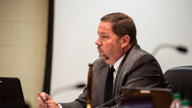 Richmond Community Schools Superintendent Todd Terrill listens to a member of the public during a board of trustees meeting on Wednesday, May 9, 2018.