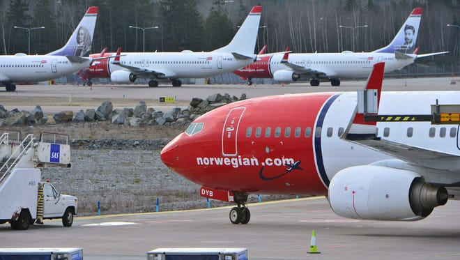 Norwegian Air Shuttle's planes sit on the tarmac at Arlanda airport in Stockholm, Sweden, on March 5, 2015.