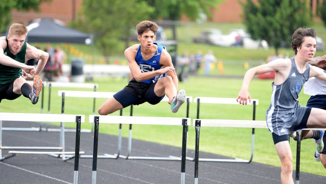 Fort Defiance's Corbin Rose (center) finished fourth in the boys 110 hurdles at Wednesday's Valley District track and field championships.