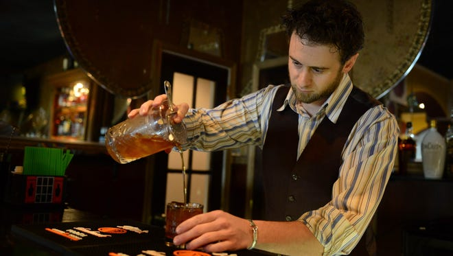 Ocean 13's Mixologist Tim Coiner Williams prepares a chai old fashioned at the new Whiskey Bar on Friday, May 18, 2018 in Ocean City, Md.