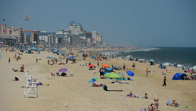 In this file photo, Umbrellas and crowds are starting to cover the beach on this Memorial Day weekend in Ocean City, Md. on Friday, May 25, 2018.