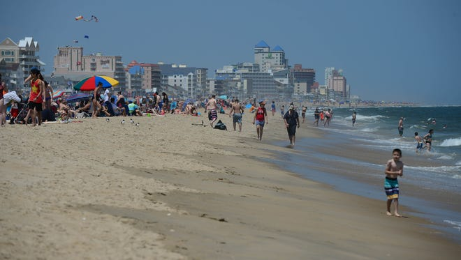 Umbrellas and crowds are starting to cover the beach on this Memorial Day weekend in Ocean City, Md. on Friday, May 25, 2018.
