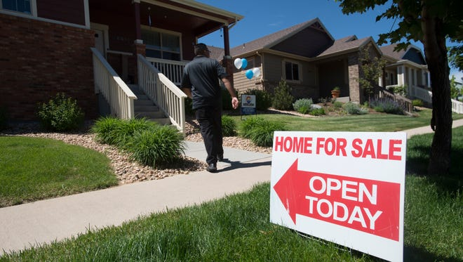 Realtor Chance Basurto prepares for an open house at a home for sale in west Greeley on Saturday, May 26, 2018.