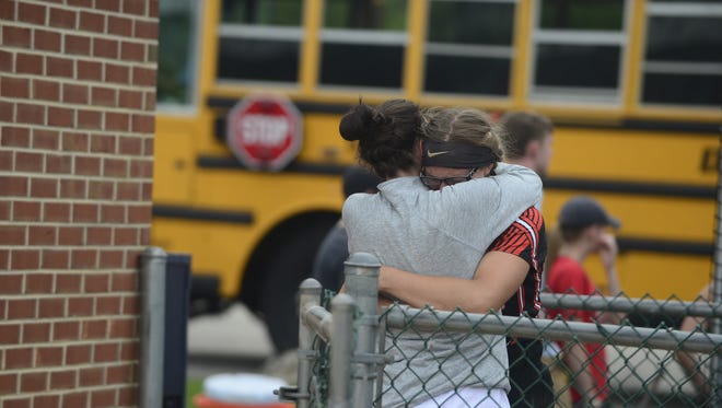 Central York pitcher Courtney Coppersmith embraces with a friend after Central Dauphin defeated Central York, 1-0, in the District 3 Class 6A championship game Wednesday, May 30, 2018 at Messiah College.