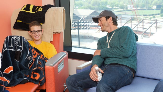 Ashton Kutcher meets with patients at the University of Iowa Stead Family Children's Hospital in June 2018.