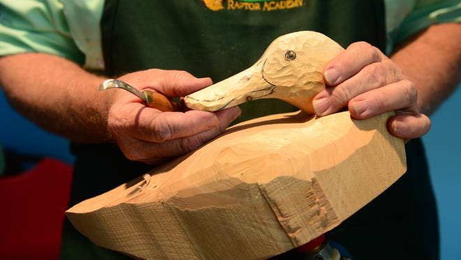 Carver Rich Smoker holds one of his carvings in progress  as The National Folk Festival introduced Chesapeake Traditions as the theme of the 2018 Maryland Traditions Folklife Area program on Tuesday, June 12, 2018 at the Ward Museum.