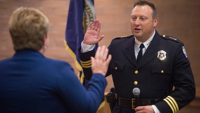 Fort Collins Police Chief Jeffrey Swoboda is sworn in during a ceremony at City Hall on Tuesday, June 19, 2018.
