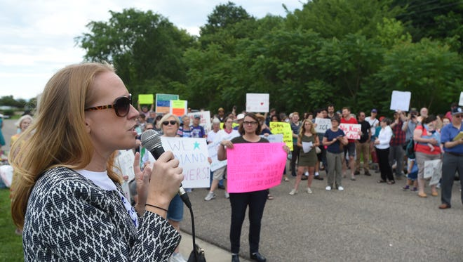 "Jennifer Lewis, the Democratic candidate for Congress from the 6th Congressional District, speaks during the ""Stop Torturing Children"" rally at the Shenandoah Valley Juvenile Center in Verona, Va., Sunday morning, June 24, 2018."