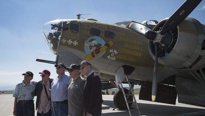 A group of World War II veterans from across Colorado pose for photo in front of a B-17 Bomber at the Northern Colorado Regional Airport in Loveland on Friday, July 14, 2017.