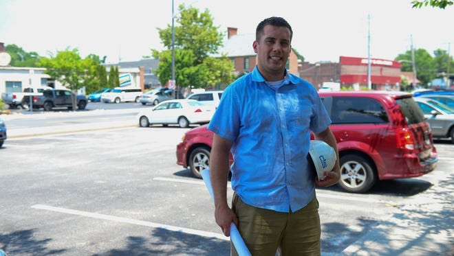 Bret Davis, Davis Simpson Holdings LLC, stands in Salisbury Lot 16 where his company will be purchasing and developing the parking lot into new apartments.