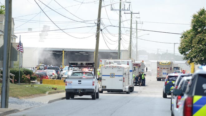 A street cleaner sweeps up the ash that was used to absorb the hazmat material that was spilled at the Mountaire Farms located in Selbyville, Del. on Thursday, July 12, 2018.