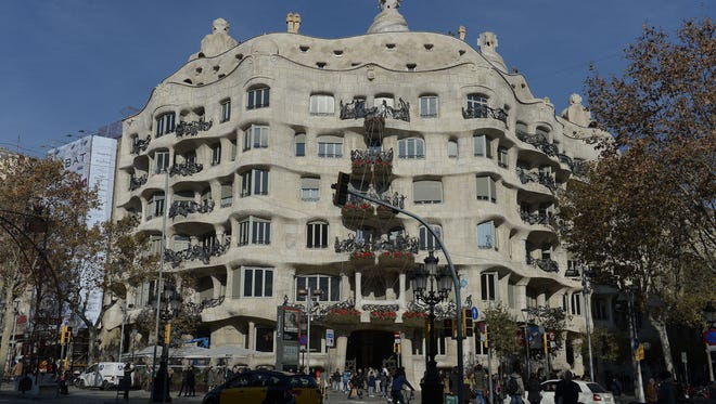 """Casa Mila or """"Pedrera""""  (the stone quarry) is an emblematic modernist building by architect Antoni Gaudi."""
