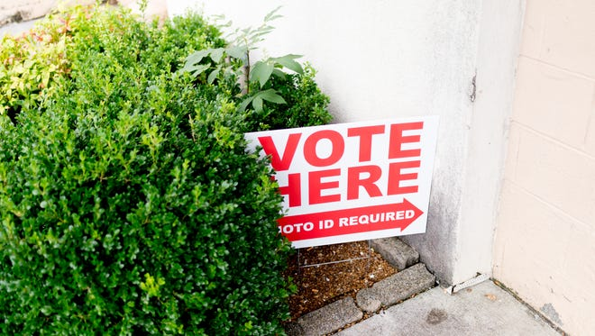 """A """"Vote Here"""" sign points voters to The Love Kitchen during early voting in Knoxville, Tennessee on Tuesday, July 17, 2018."""