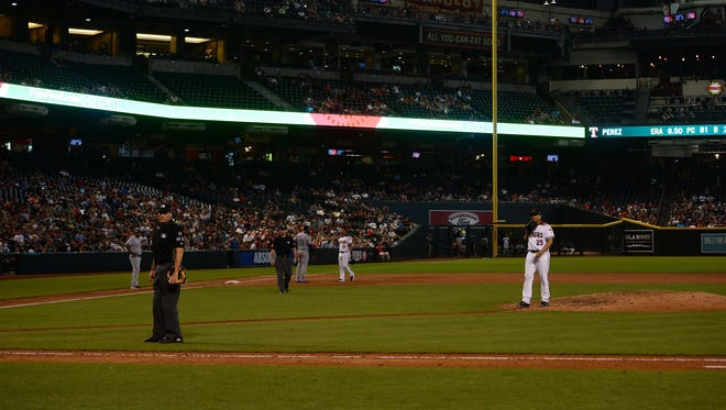 Jul 30, 2018: Arizona Diamondbacks relief pitcher Jorge De La Rosa (29) and umpires look on during the sixth inning power outage during the game against the Texas Rangers at Chase Field.