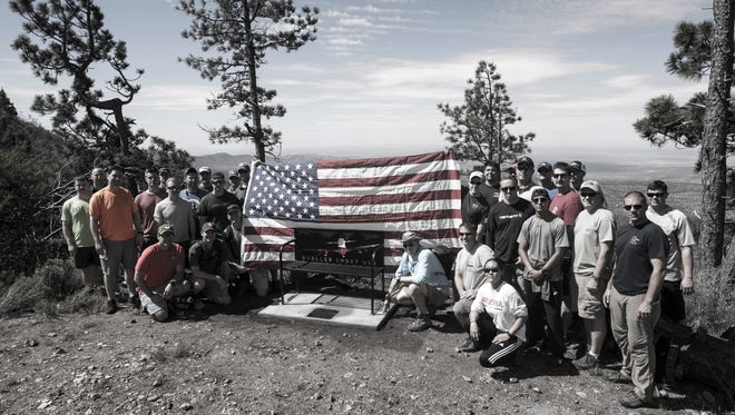 """n memory of Lt. Christopher """"Bueller"""" Short, U.S. Navy pilot, a bench was placed at the end of the Rim Trail in the Tularosa Basin, N.M., July 13, 2018. Short lost his life when an A-29 Super Tucano crashed over the Red Rio Bombing Range, June 22, 2018."""
