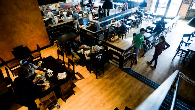 Illegal Pete's holds a soft opening event in its new Fort Collins location Sunday, Nov. 9, 2014. The restaurants plans to host live music events on its outside patio and on the raised eating area inside.