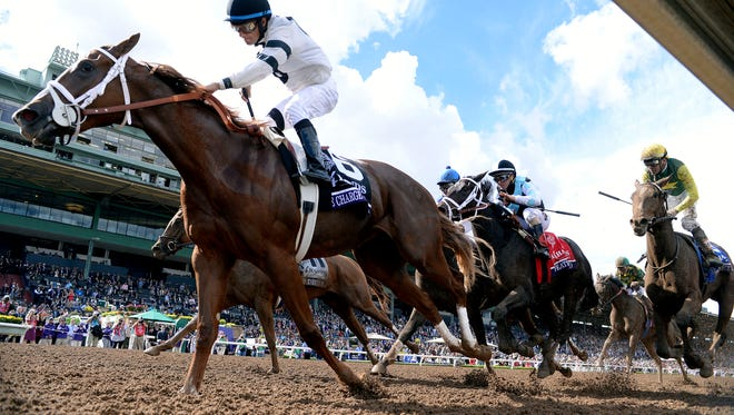 November 1, 2014; Santa Anita , CA, USA; Victor Espinoza aboard Take Charge Brandi races to the finish during race four of the 2014 Breeders Cup Championships at Santa Anita Park.  Mandatory Credit: Richard Mackson-USA TODAY Sports