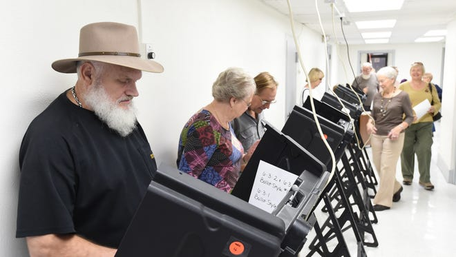 More than 100 people in Baxter County had cast their ballots in this 2014 file photo during the first 90 minutes of early voting. Poll workers said turnout was was running close to average. Early voting for the 2016 election starts Tuesday, Feb. 16.