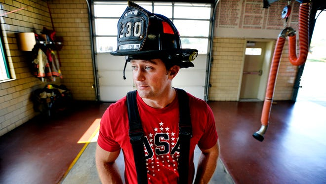 Casey Wickline poses for a portrait inside Greenville Fire Department Station 3 on Augusta Road on  Oct. 1, 2014. Wickline is a Greenville firefighter who is attempting to make the U.S. bobsled team.
