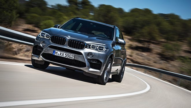 BMW is showing its newest performance SUVs, the X5 M and X6 M. This X5 M has a top speed of 155 miles per hour