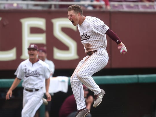 Mississippi State's Elijah MacNamee celebrates his walk-off 3-run home run to beat the Seminoles 3-2 in their NCAA Regional elimination game at Dick Howser Stadium in Tallahassee, Fla. on Saturday, June 2, 2018.