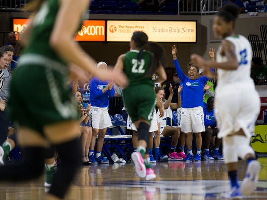 The FGCU bench gets pumped up after the team hits a three-pointer in the first half of action during the semifinal game of the Atlantic Sun tournament at Alico Arena Wednesday, March 8, 2017 in Estero.