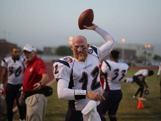 Todd Marinovich, former quarterback for USC and the Raiders, warms up for his first professional game in 17 years. Marinovich quarterbacks for the So Cal Coyotes developmental pro league team. They beat the California Sharks 73-0.