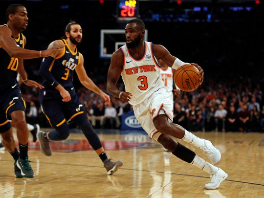 New York Knicks forward Tim Hardaway Jr. (3) drives to the basket past Utah Jazz guard Alec Burks (10) during the first quarter at Madison Square Garden.