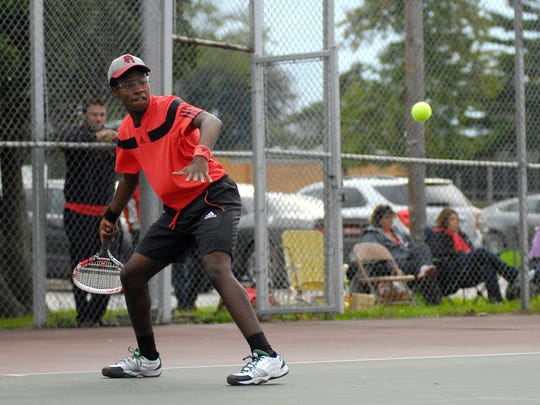 Big Reds' Cameron Lee prepares to return a hit, Mon, Sept 15, during high school tennis action against Marysville at Port Huron High.