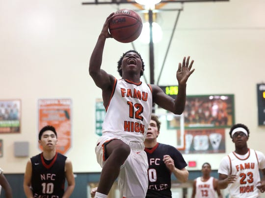 FAMU DRS' A'drelin Robinson drives down the lane for