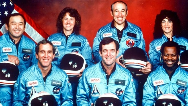 The crew of the space shuttle Challenger is seen in this 1986 photo. Bottom row, from left, Mike Smith, Dick Scobee and Ron McNair. Top row, from left, Ellison Onizuka, Christa McAuliffe, Greg Jarvis and Judith Resnik.