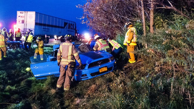A tractor trailer rear ended a car on I-490 in Riga, trapping the driver of the car.