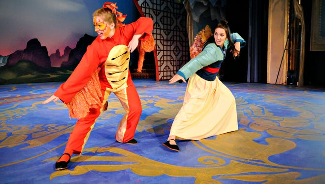"""The Chinese dragon Mushu, played by Mackenzie Krueger (left), and Mulan, played by Eden Garman, set off to fight the Huns in """"Disney's Mulan Jr."""" during rehearsal Thursday at the Paramount Theatre."""