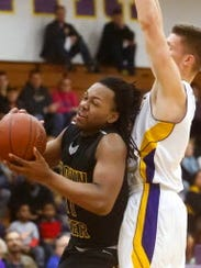Jay Gentry (left) led his team with 36 points in two