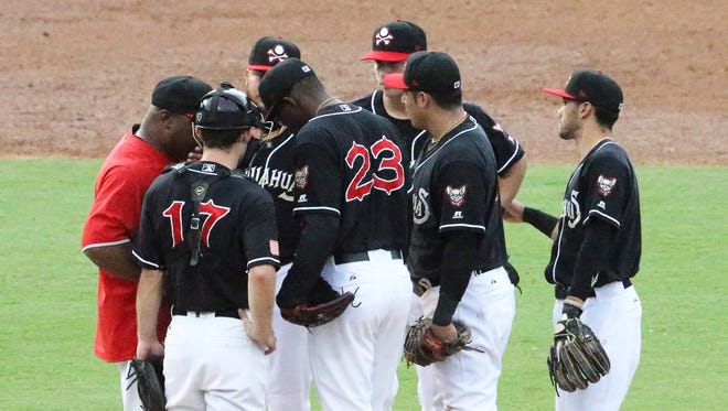 The El Paso Chihuahuas gather around pitcher Tyrell Jenkins after the Salt Lake Bees ran up a 6-0 lead early in their game Thursday night at Southwest University Park. Jenkins was later relieved by Adam Cimber, 27.